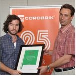 Corobrik:Jurie Swart of the University of the Free State is the regional winner in the 2011 Corobrik Architectural Student of the Year Event. He is pictured receiving his award from Gary Westwood, Corobrik Sales Manager Free State.